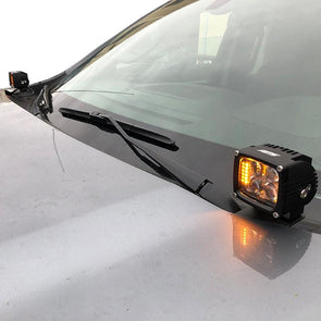 An image of an APS accent light mounted on the hood of a 2019 Chevy Silverado