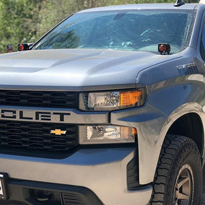 An image of APS ultra beam amber light pods mounted on the hood of a 2019 Chevy Silverado
