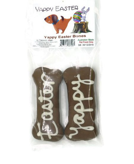 "Bone shaped biscuits, coated in carob with ""Yappy"" & ""Easter"" handwritten in yoghurt, in clear sealed bag with cheeky Easter label."