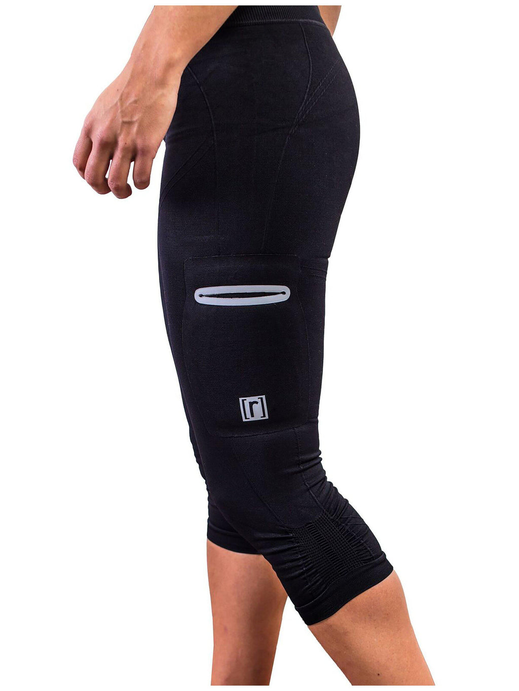 Black compression pant with patented fully seamless front and pockets. Side view.