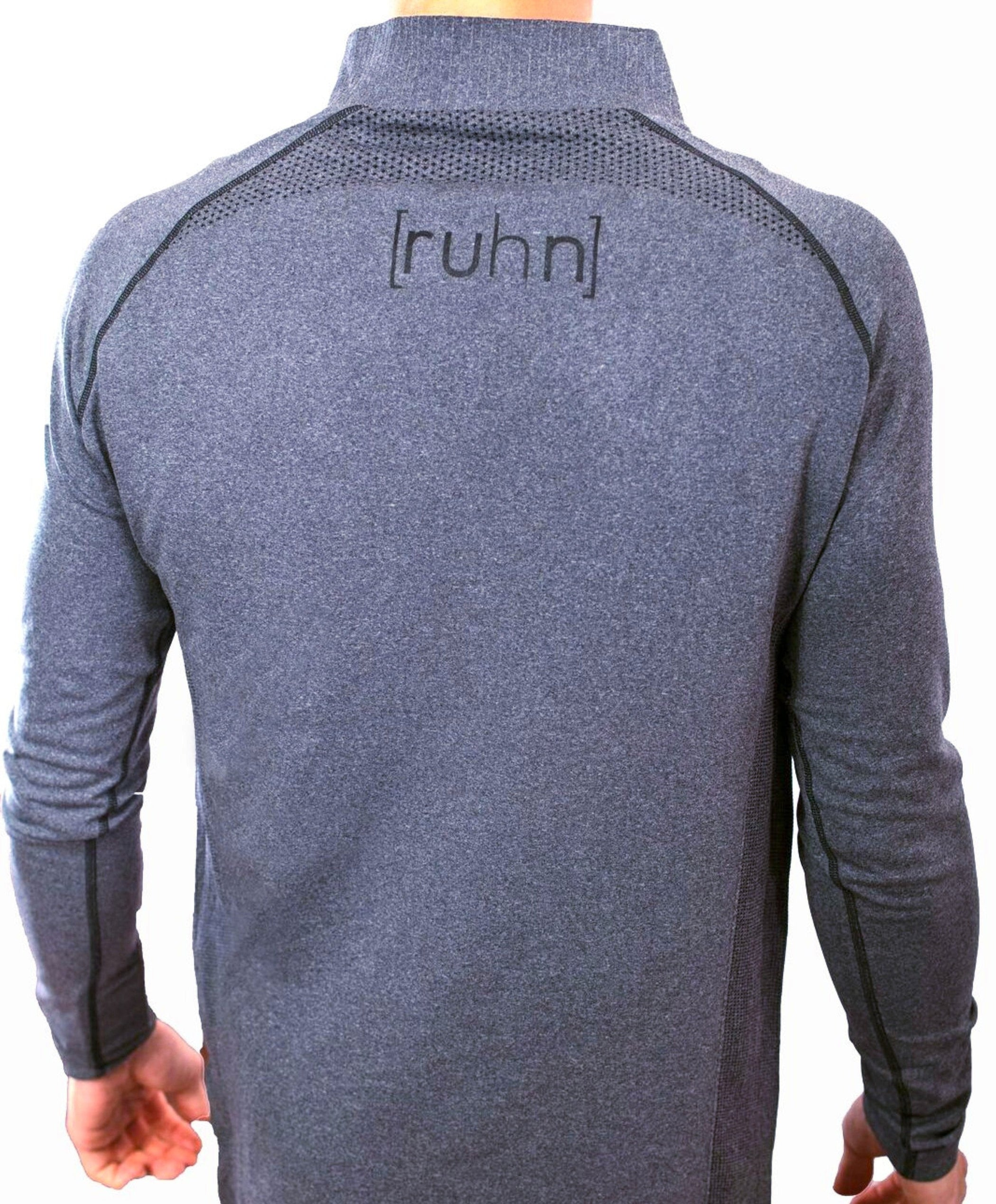 Graphite quarter-zip compression top with bonded zipper. Back view.