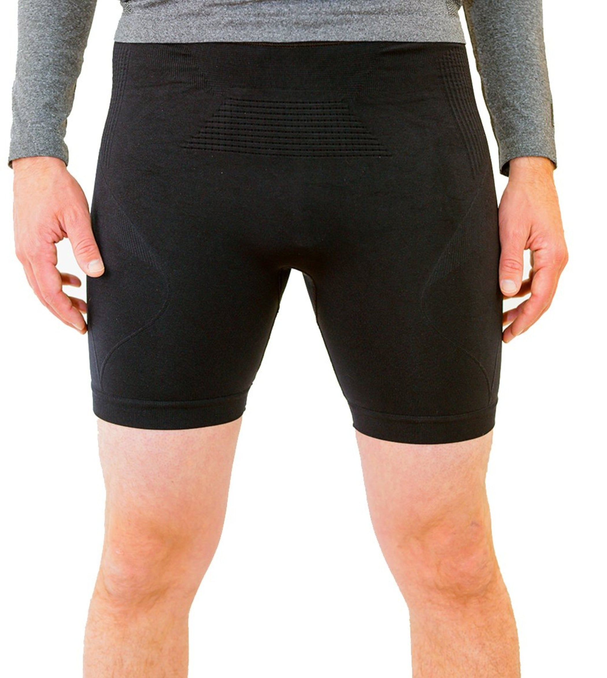 Black compression shorts with patented fully seamless front, pockets and 6 inch inseam. Front View.