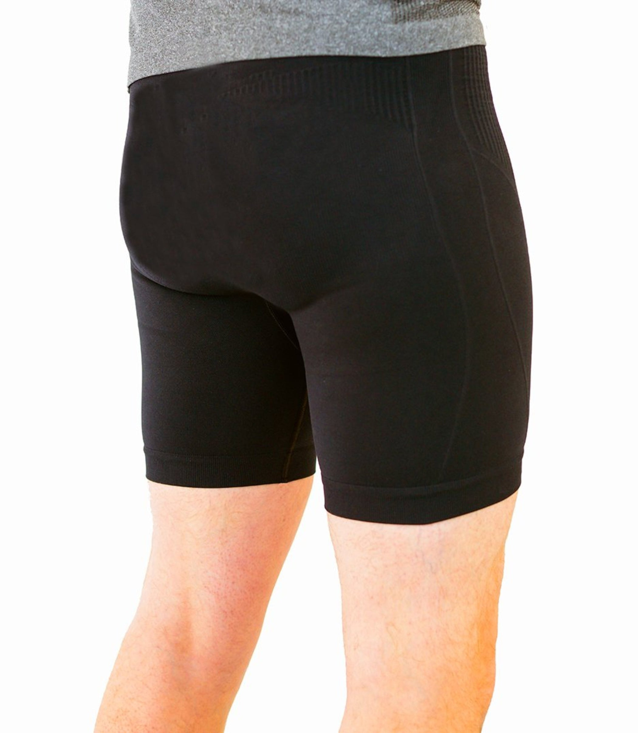 Black compression shorts with patented fully seamless front with 6 inch inseam. Back view.