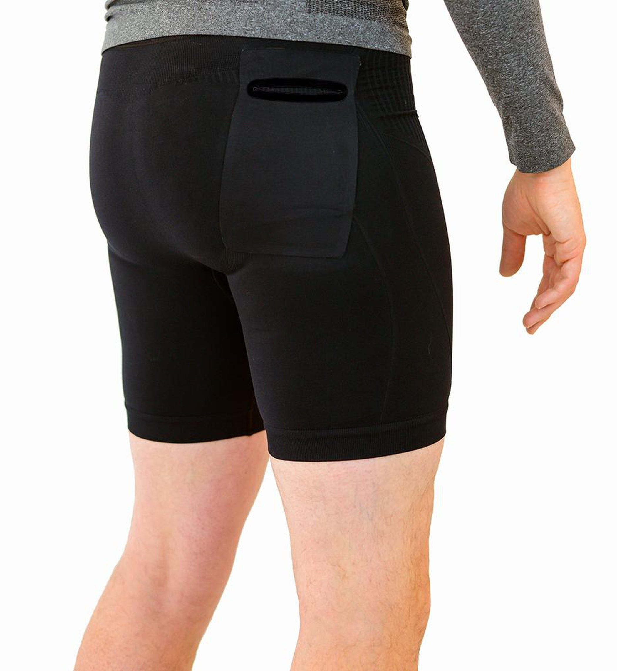 Black compression shorts with patented fully seamless front, pockets and a 6 inch inseam. Back View.