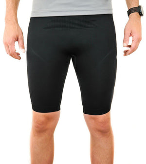 Black compression shorts with patented fully seamless front, pockets and 9 inch inseam. Front view.