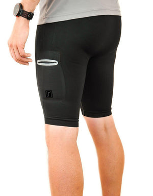 Black compression shorts with patented fully seamless front, pockets and 9 inch inseam. Side view.