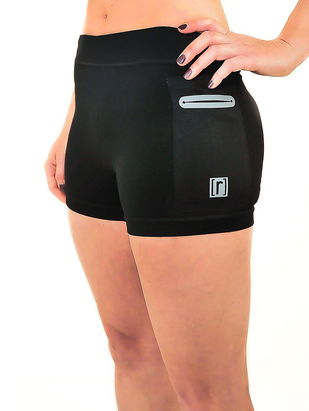 Black compression shorts with patented fully seamless front and pockets. Side view.