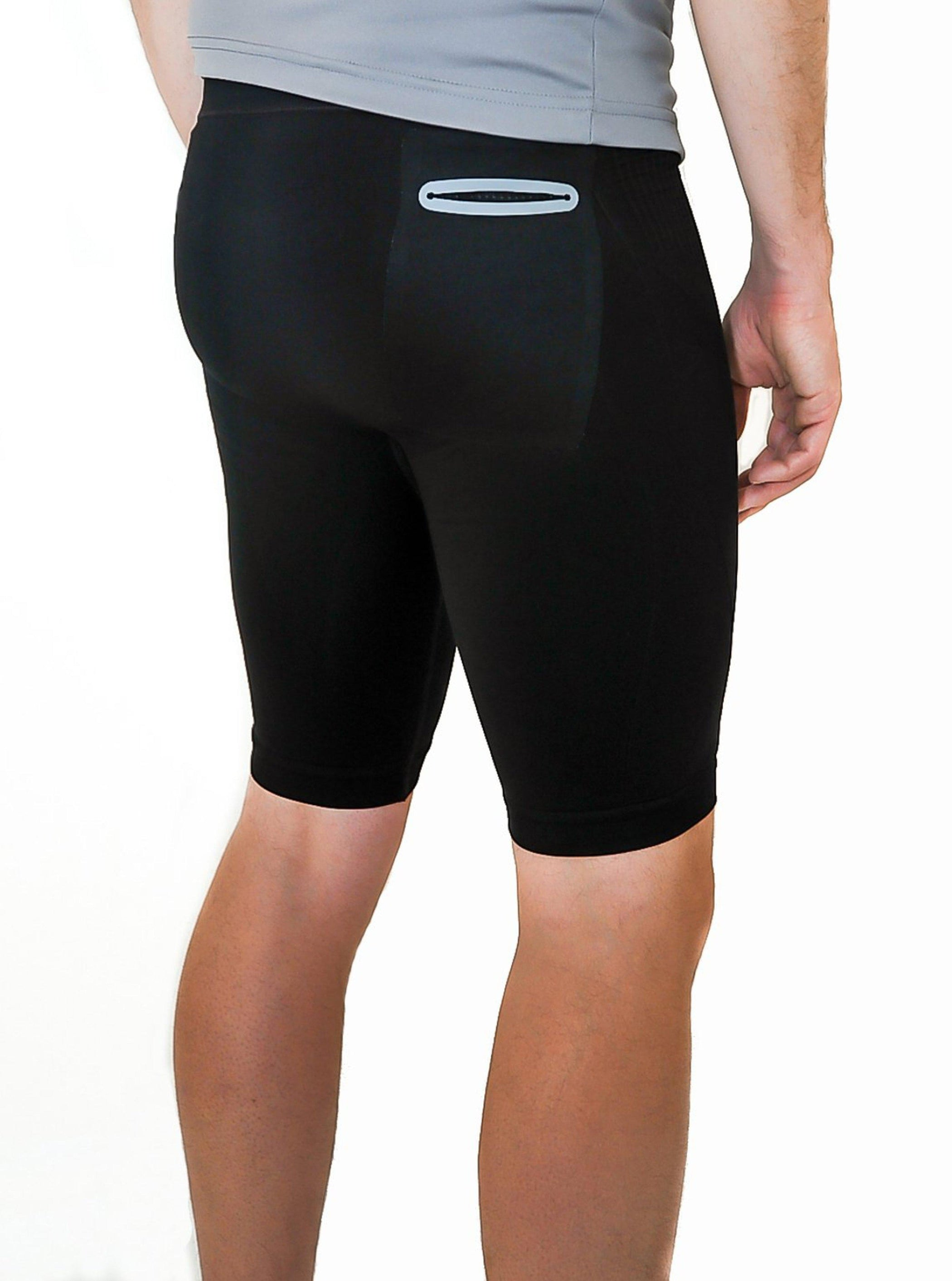 Black compression shorts with patented fully seamless front, pockets and 9 inch inseam. Back view.