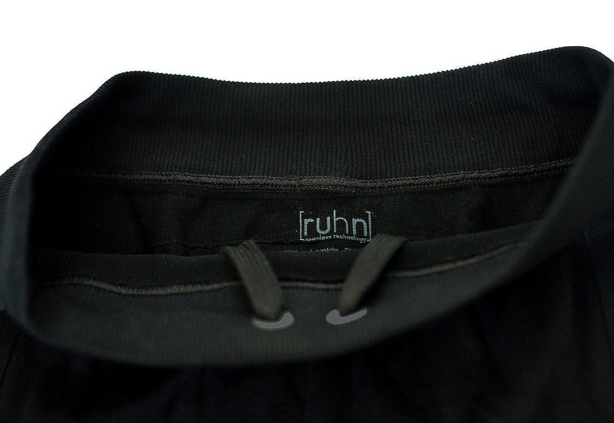 Black compression pant with patented fully seamless front, pocket. Drawstring.