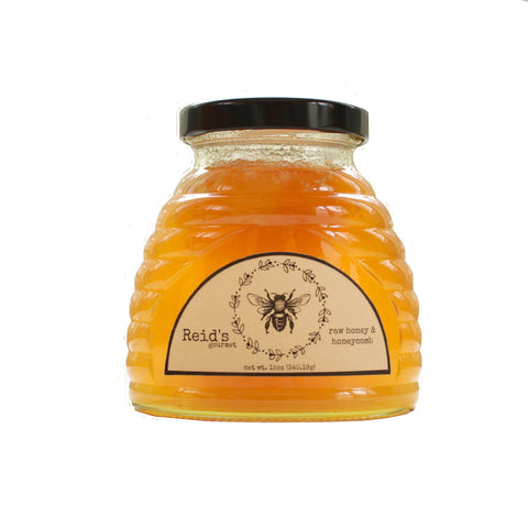 "1"" chunk honeycomb in raw honey in hive shaped glass jar 12 ounces"
