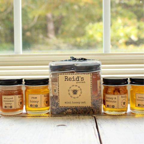 mini gift box with four one ounce jars with raw honey, cinnamon honey, honeycomb and walnuts and honey