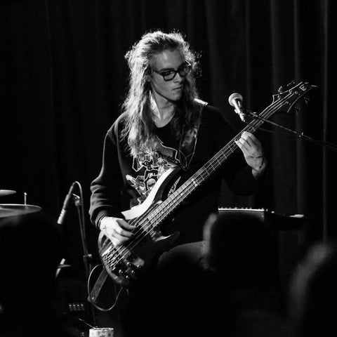 Calvin playing bass on stage