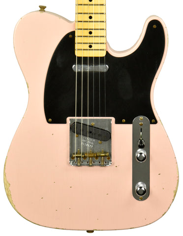 A Fender Telecaster in Shell Pink with the classic Tele pickup configuration