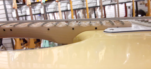 Side shot of a scalloped fingerboard. Them's deep scallops!