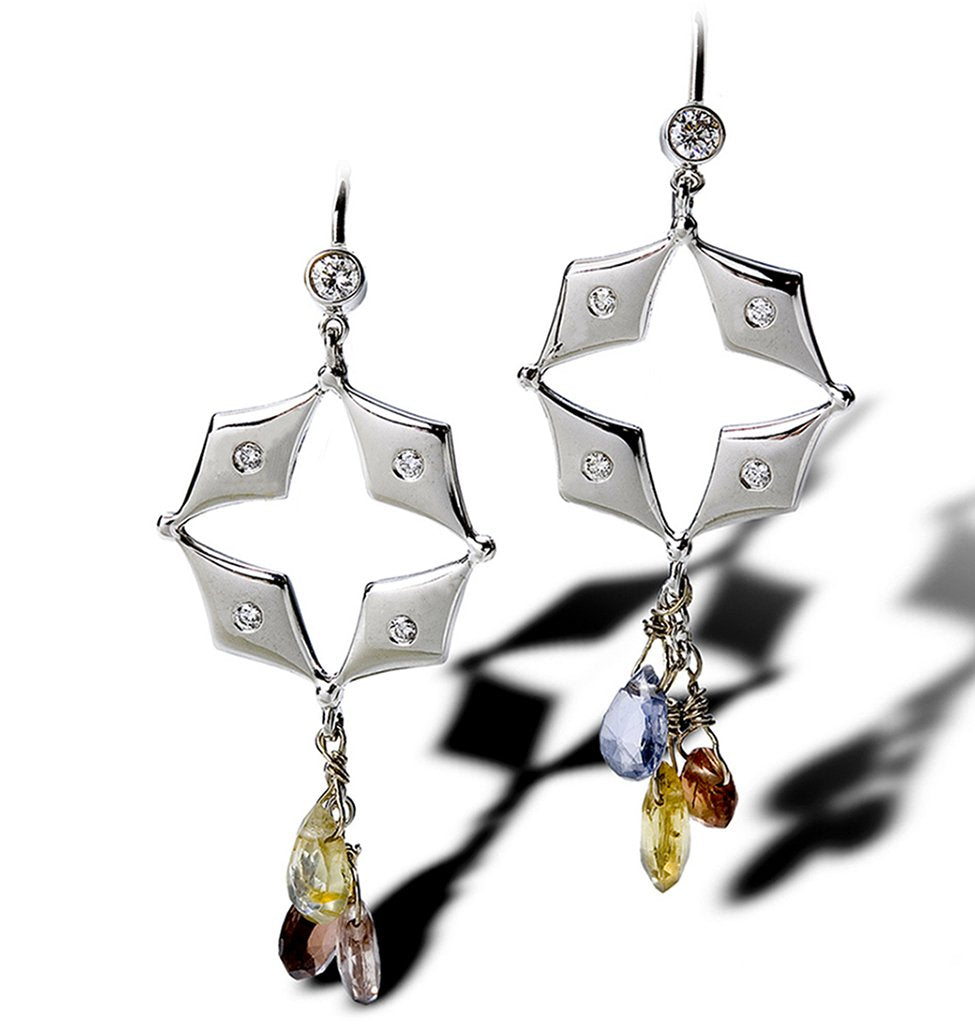 A diamond star cut out earring with dangle fanciful colored stone sapphires