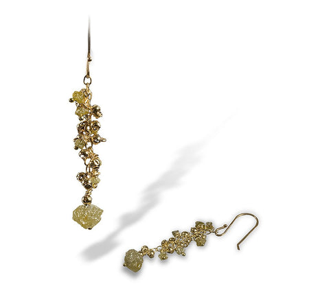 A cluster of enriched 18K yellow fine gold beads and tiny rough diamond earrings