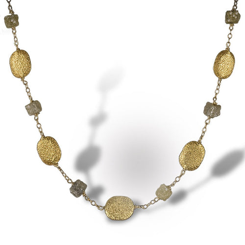 Textured necklace of enriched 18K yellow fine gold coin-like pieces with rough diamonds