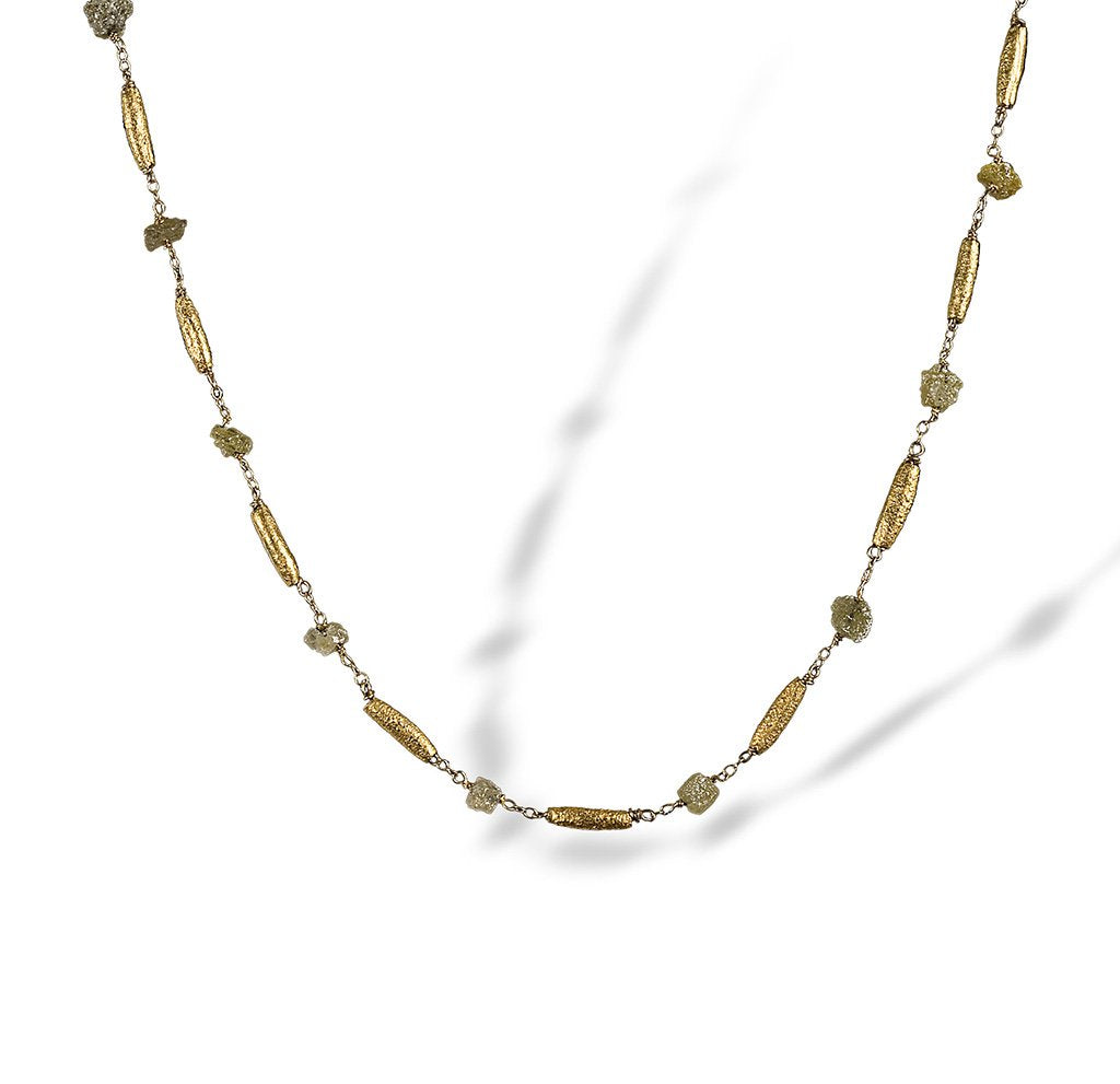 Textured necklace of enriched 18K yellow fine gold rounded tubular pieces with rough diamonds