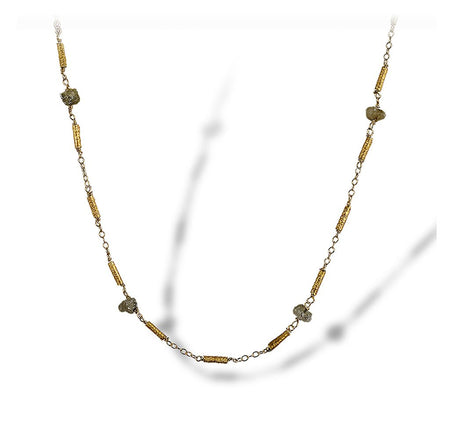 Textured necklace of enriched 18K yellow fine gold petite tubular pieces with rough diamonds