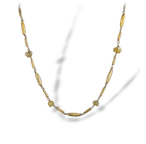 Textured necklace of enriched 18K yellow fine gold combination of tubular sizes with rough diamonds