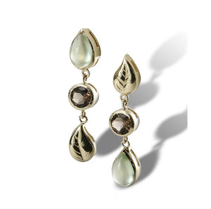 An earring with an alternating design of leaves and gemstone drops in fine gold