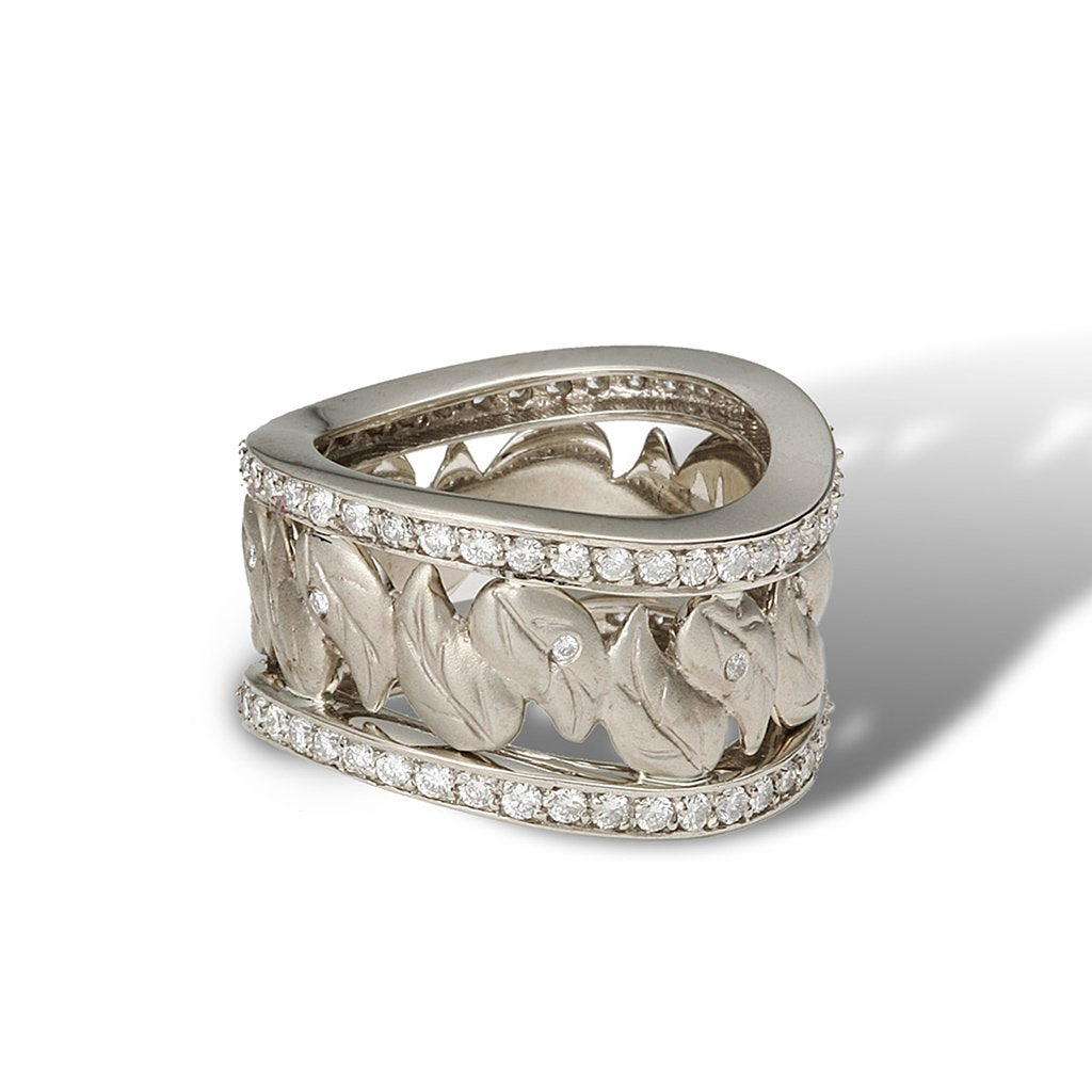 An eternity band of a unique wavy pathway of paisley leaves and diamonds