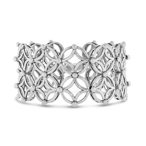 A geometric bracelet in a matrix pattern of diamond and circle motifs with beaded detailing