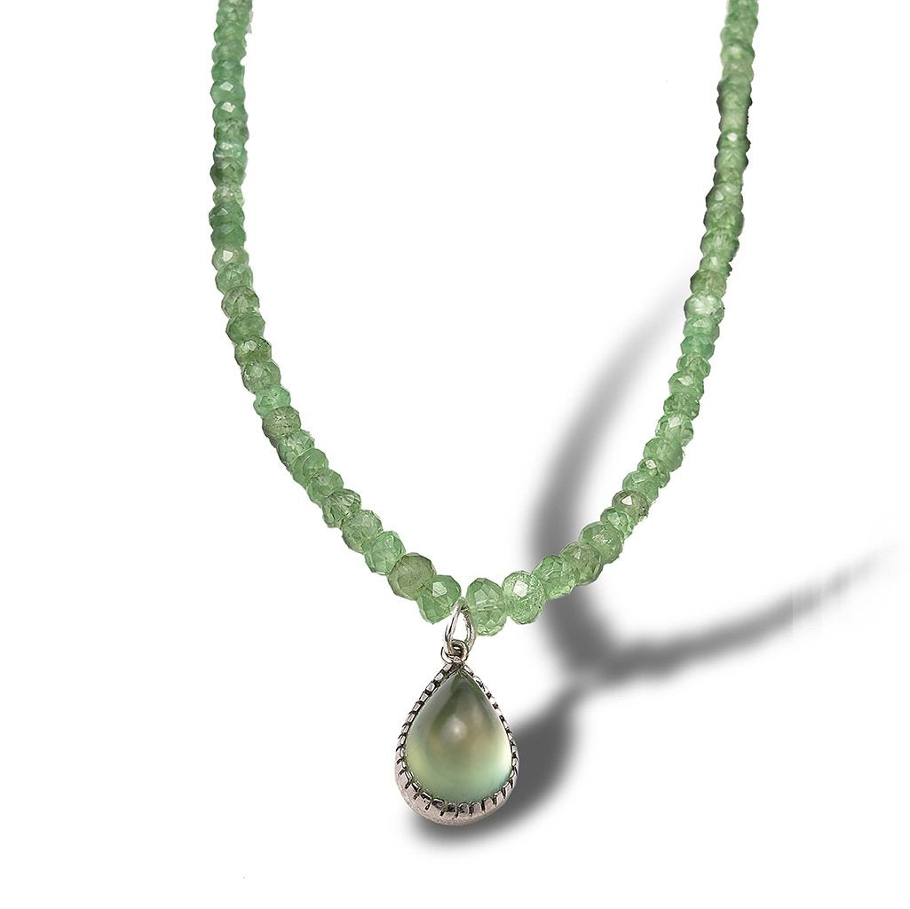 Fine green semi-precious stones with a finishing touch of a green translucent pear-shaped dangle stone pendant