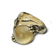 A bypass kitty cat ring, in gold and blackened finish, in its playful pose