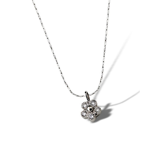 Tiny diamonds sparkle in this petite budding floral daisy pendant