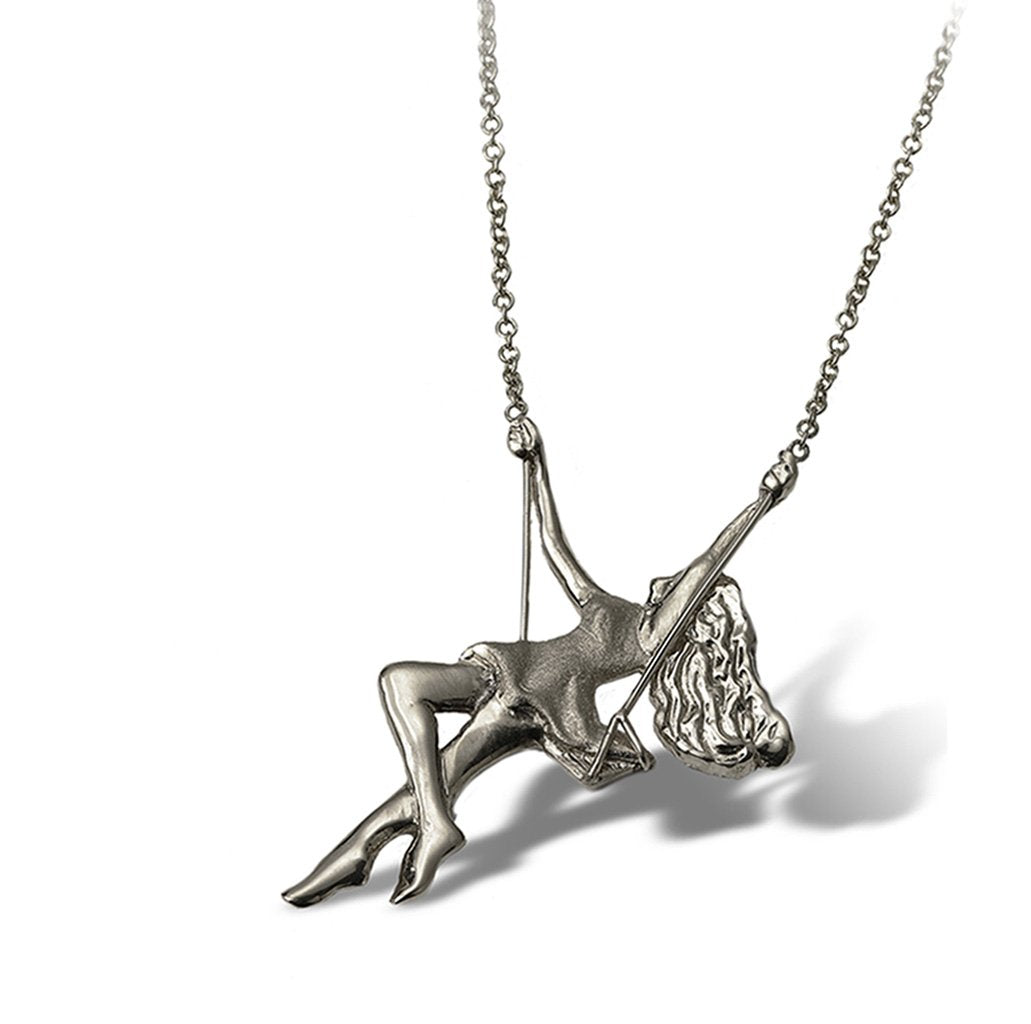 A free spirited pinup golden girl pendant necklace swings playfully along