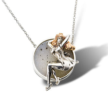 A novelty theme of a vintage pinup girl pendant in fine gold craftsmanship