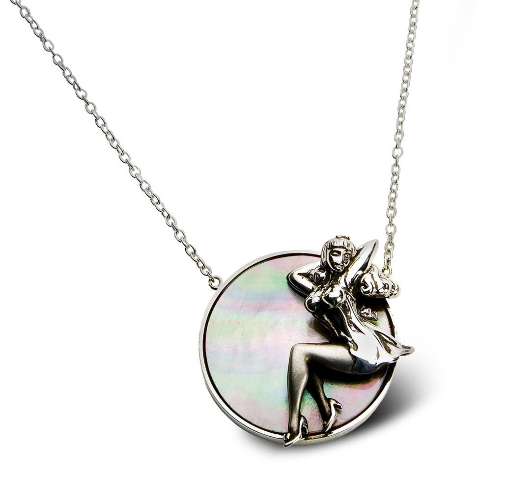 A novelty theme of a vintage pinup girl pendant in fine silver craftsmanship