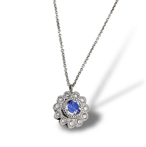 A floral motif daisy pendant in antiquing with diamonds and moonstone