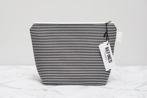 Handmade large makeup bag in a black and white striped print.