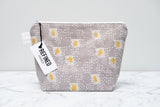 Handmade large makeup bag in a grey and yellow confetti print.