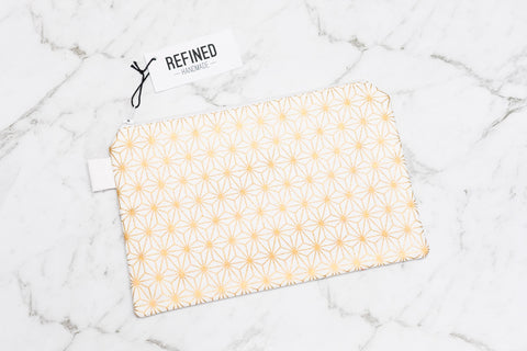 Handmade large pouch in a metallic gold star print.