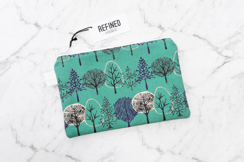 Handmade large pouch in a green forest print.