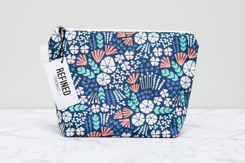 Handmade large makeup bag in a navy blue ocean print.