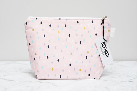 Handmade large makeup bag in a blush pink droplets print.