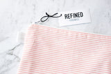 Handmade large pouch in a pink and white striped print.