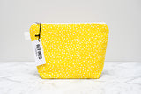 Handmade large makeup bag in a yellow and white dot print.