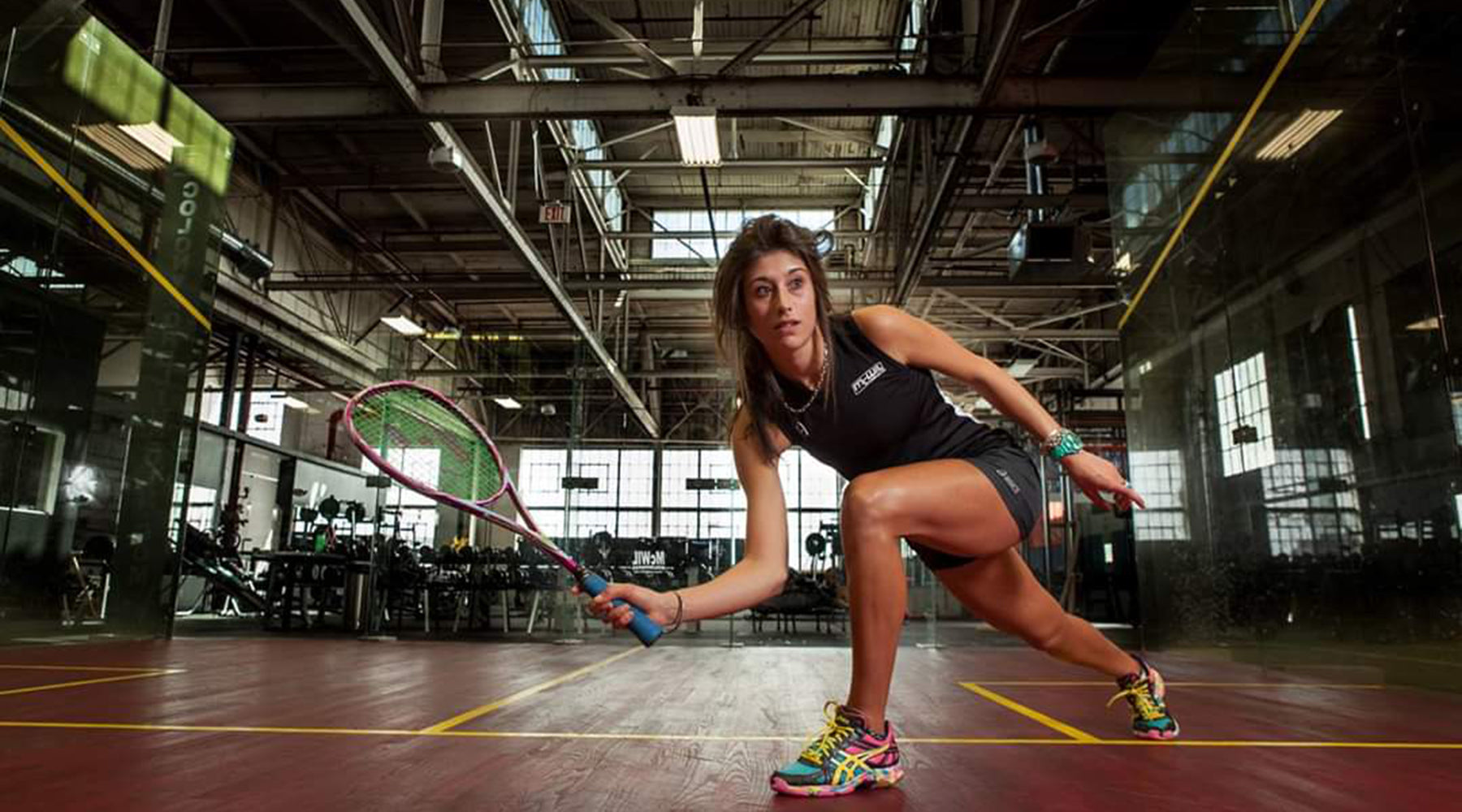Photo of Megan Craig, NZ Professional Squash Player doing what she loves.