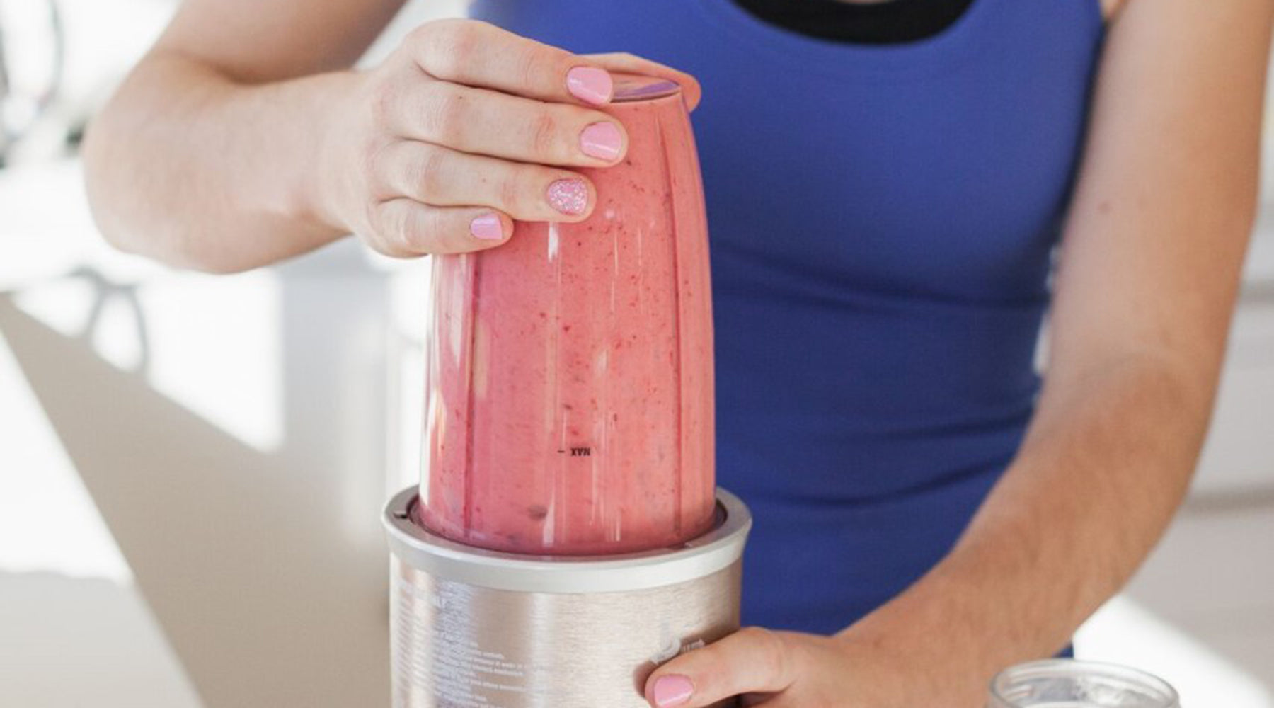 Photo of Renee Norman from Real Health NZ making her nutritious breakfast smoothie recipe