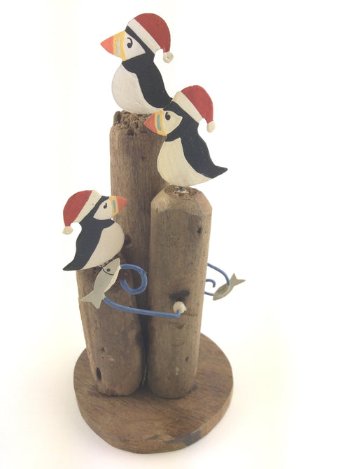 Puffins with Santa Hat on Driftwood
