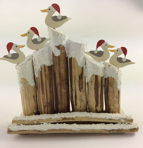 Seagull with Santa Hat on Driftwood