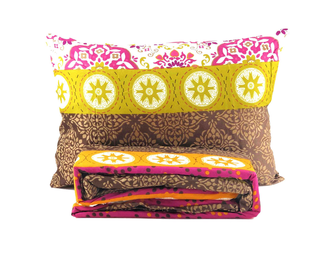 1 floral abstract pillow and folded fitted sheet