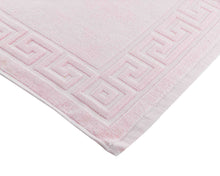 Opened light pink cotton bath mat by Idaman Suri