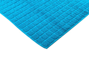 Opened light blue cotton bath mat by Idaman Suri
