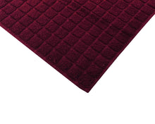 Opened dark red cotton bath mat by Idaman Suri